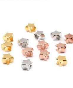 Stjärnor - CCB plast pärlor - 50st guld